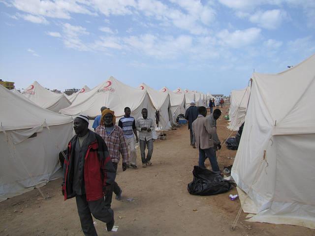 Flüchtlinge in Libyen Viele Flüchtlinge und Migranten stranden auf ihrem Weg in Libyen. Dort erwartet sie allerdings oft eine Menschenunwürdige Behandlung. | Bild: © European Commission DG ECHO [CC BY-ND 2.0]  - Flickr