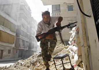 Syrian Rebel Ein Soldat der Freien Syrischen Armee im zerstörten Aleppo.   Bild: © a.anis [CC BY-ND 2.0]  - Flickr