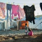 Syrisches Flüchtlingscamp Ein syrisches Flüchtlingscamp in Erbil im Nordirak: Der jetzige Konflikt könnte eine neue Fluchtwelle nach Europa auslösen. | Bild (Ausschnitt): © Mustafa Khayat [CC BY-ND 2.0] - Flickr