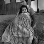 Symbolbild: Slavadorianische Frau flüchtete mit Kind vor drohender Gewalt | Bild (Ausschnitt): © Moody College of Communication [CC BY-SA 2.0] - Flickr